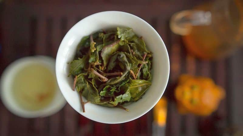 brewed green tea leaves in gaiwan