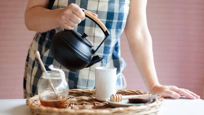 pouring kettle into cup
