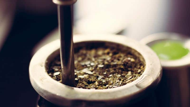 yerba mate leaves brewing in gourd