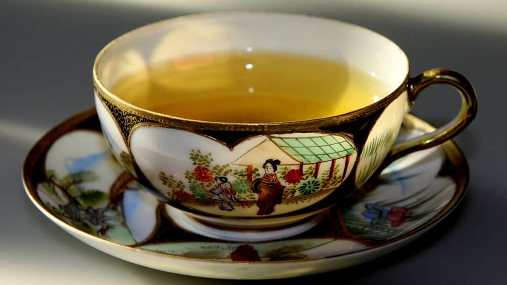 Beautiful cup with green tea