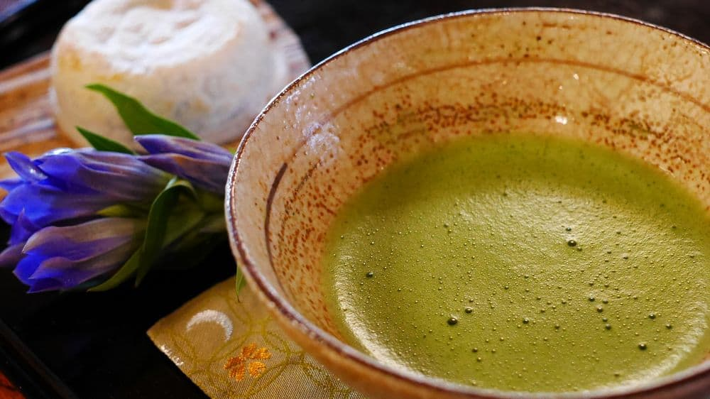 Cup of matcha with food