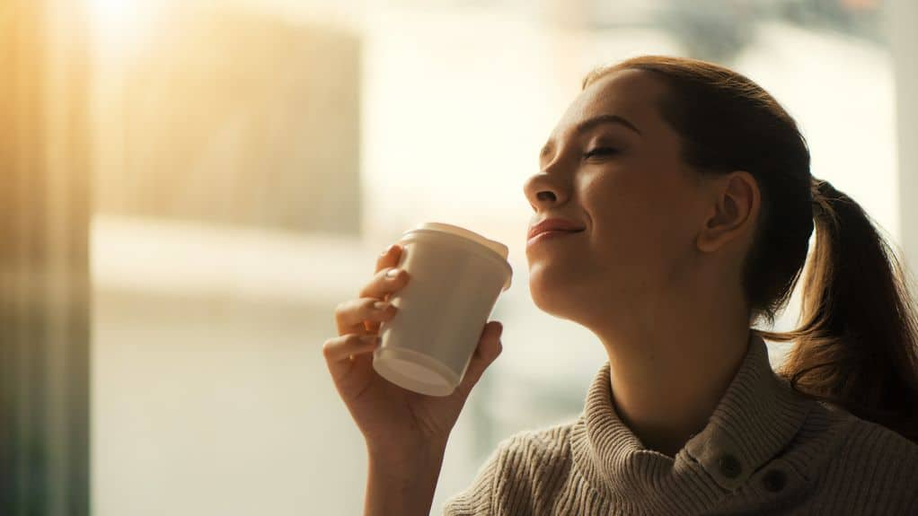 Woman enjoying flavor of tea