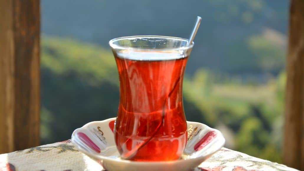 Hot cup of tea in the summer