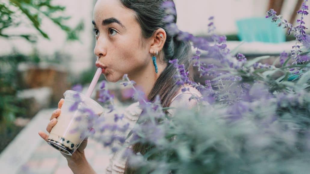 Woman drinking boba tea